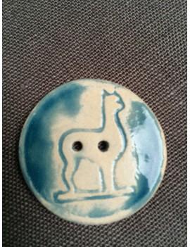 Bouton alpaga en céramique émaillée bleu foncé
